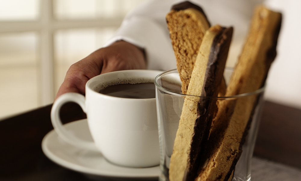 Biscotti and coffee on a tray